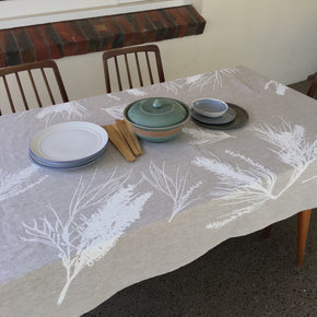 Photo of screenprinted tablecloth depicting grevillea flowers.