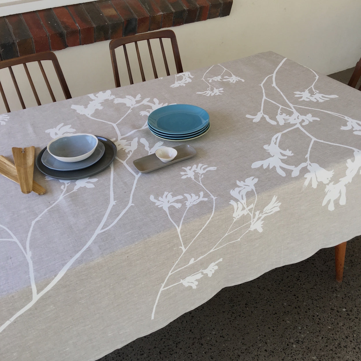 Photo of screenprinted tablecloth depicting kangaroo paw plants.
