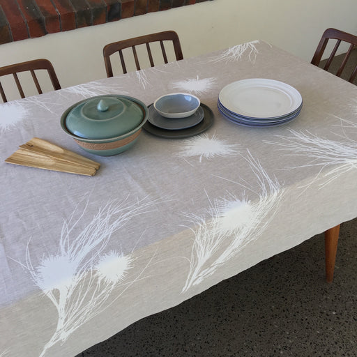 Photo of screenprinted tablecloth depicting salt spinifex plants.