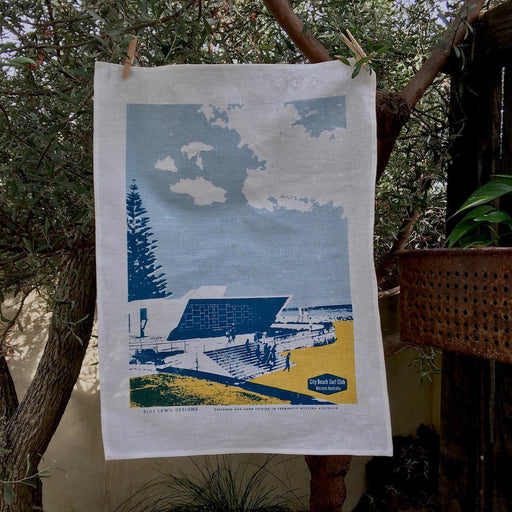 Photo of City Beach screenprinted on a tea towel.