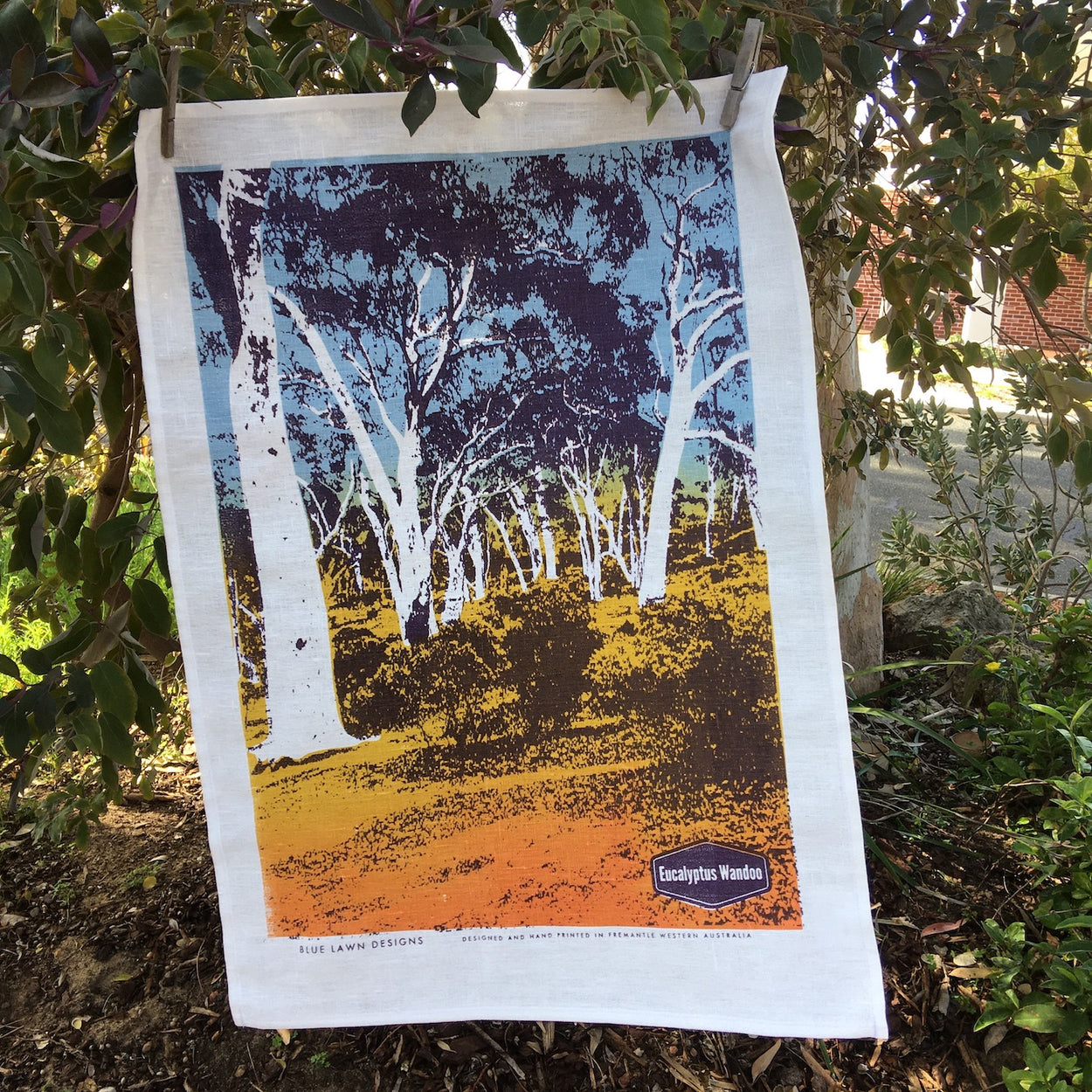 Photo of Eucalyptus wandoo screenprinted on a tea towel.
