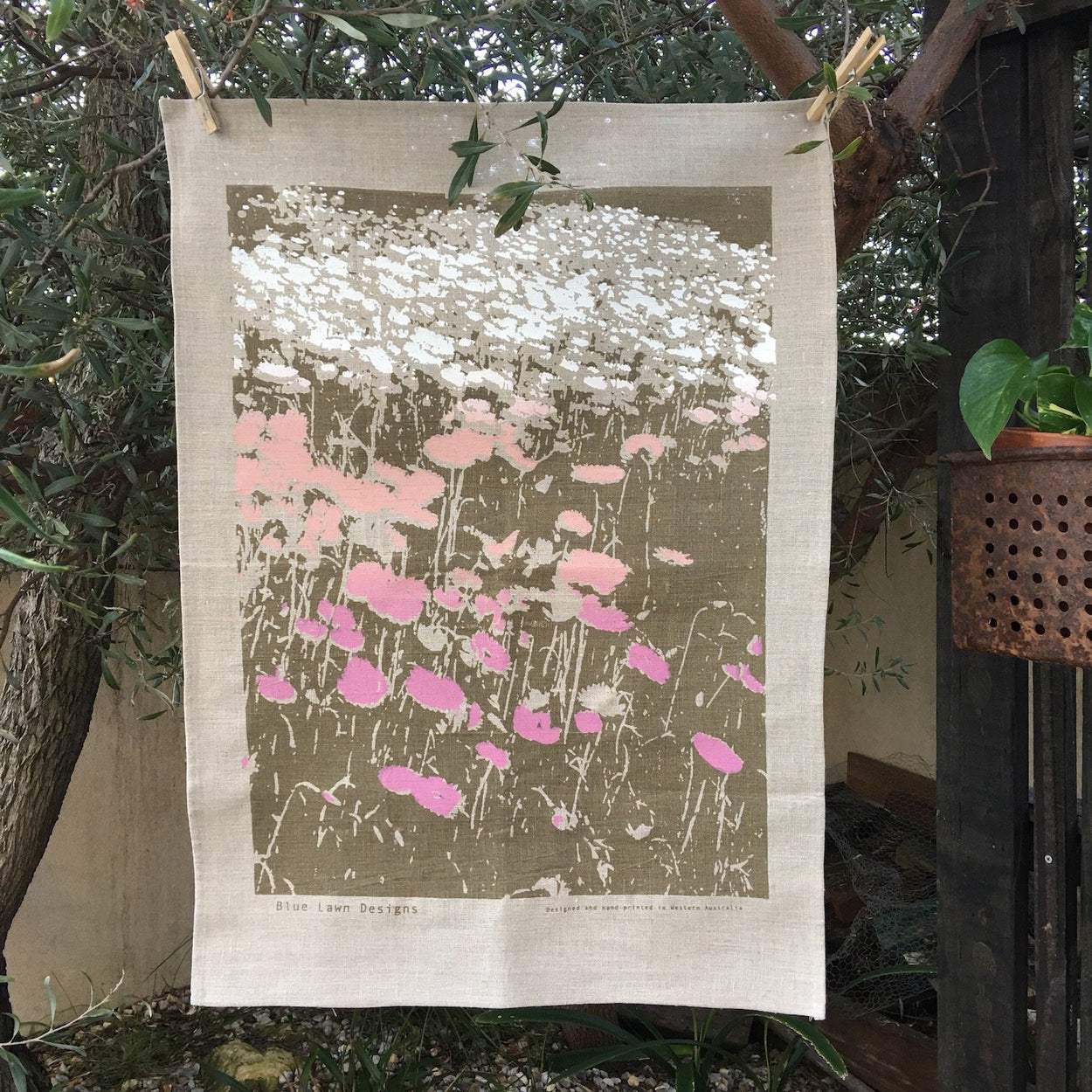 Photo of Everlasting daisies screenprinted on a tea towel.