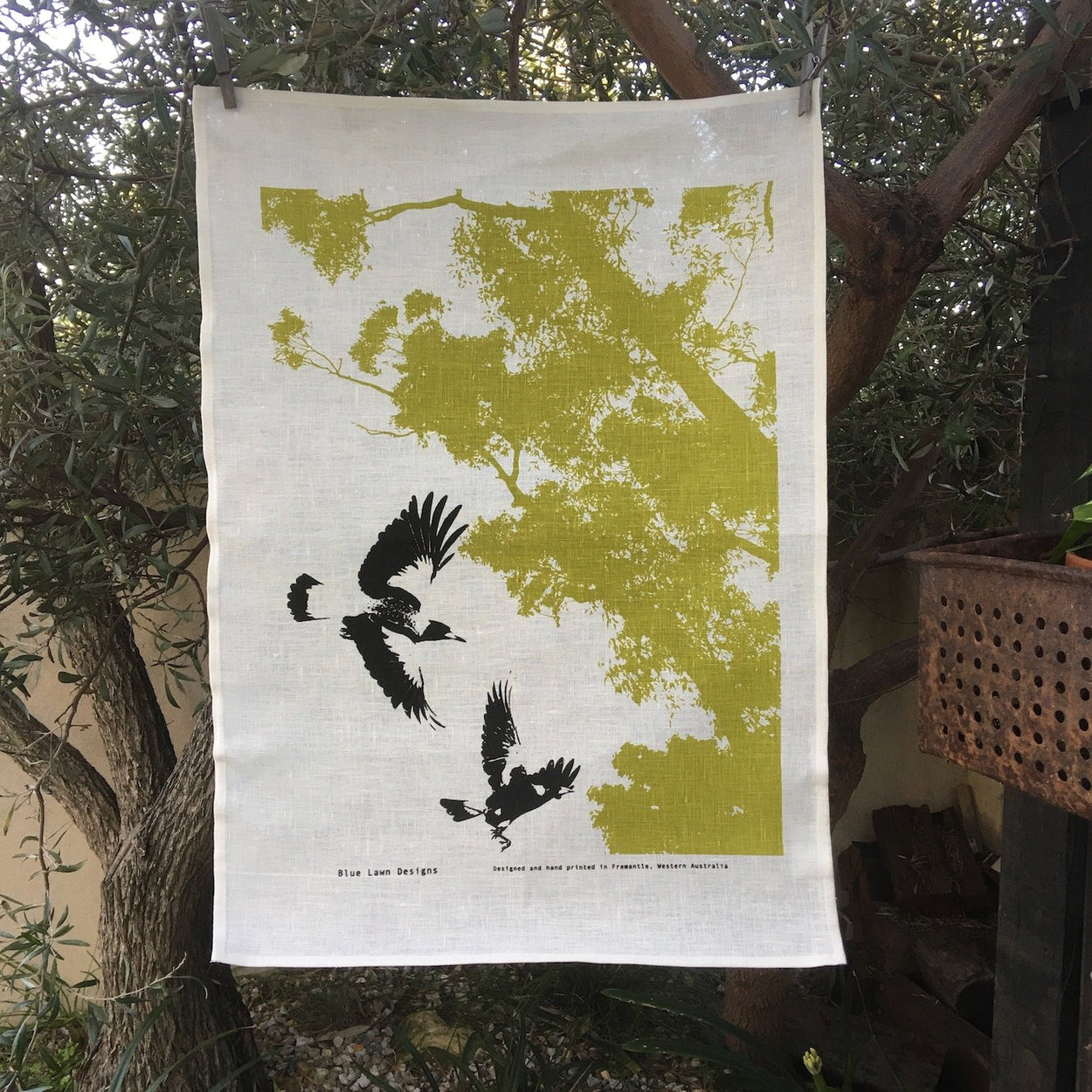 Photo of magpies screen printed on a tea towel.