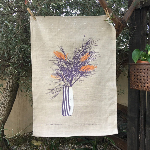 Photo of a Grevillea screenprinted on a tea towel.