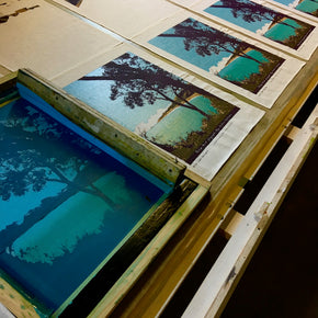 Photograph of linen tea towels being screenprinted.