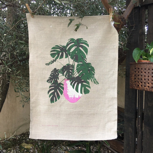 Photo of a Monstera plant screenprinted on a linen tea towel.