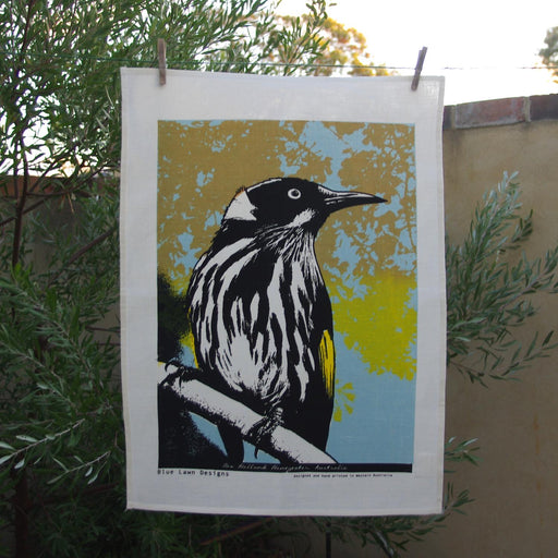 Photo of a New Holland honeyeater screenprinted on a tea towel.