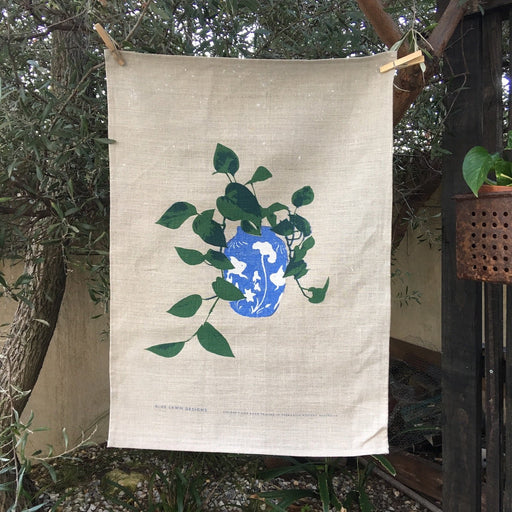 Photo of Philodendron screenprinted on a linen tea towel.