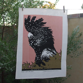 Photo of a Red-tailed Black Cockatoo screenprinted on a tea towel.
