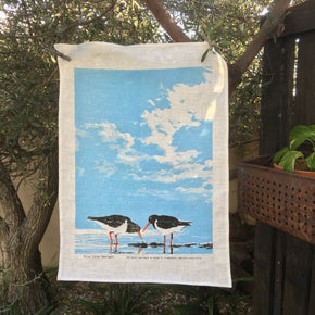 Photo of shorebirds screenprinted on a tea towel.