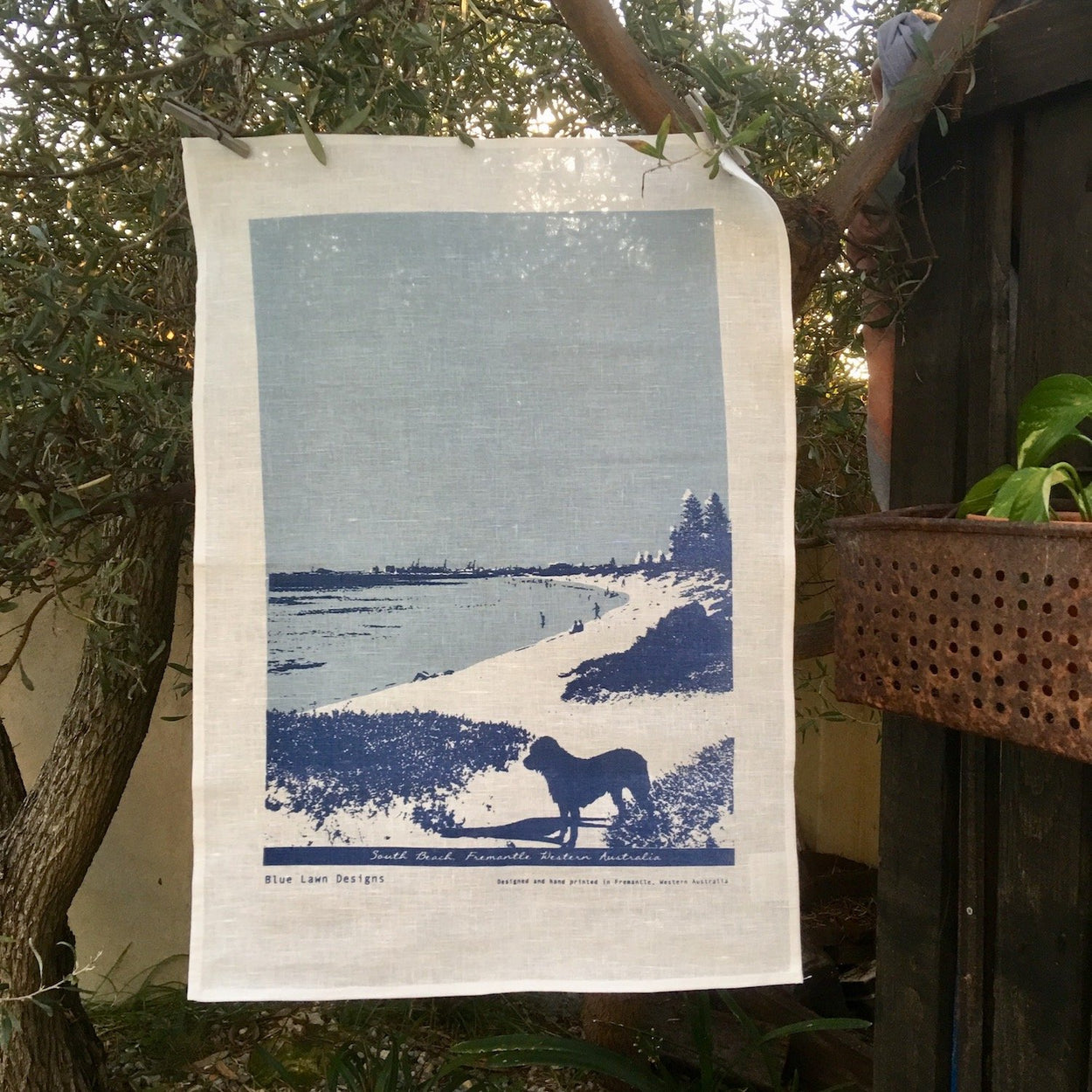 Photo of a dog at South Beach, Fremantle screenprinted on a tea towel.