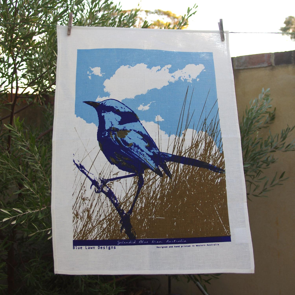 Photo of a Splendid Blue Fairywren screenprinted on a tea towel.