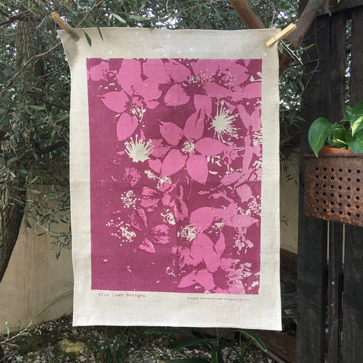Photo of a short-leafed starflower plant screenprinted on a tea towel.