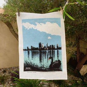 Photo of a black swan on the Swan River at South Perth screenprinted on a tea towel.