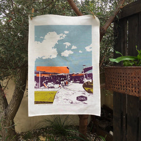 Photo of The Orange Box cafe, Leighton Beach screenprinted on a tea towel.