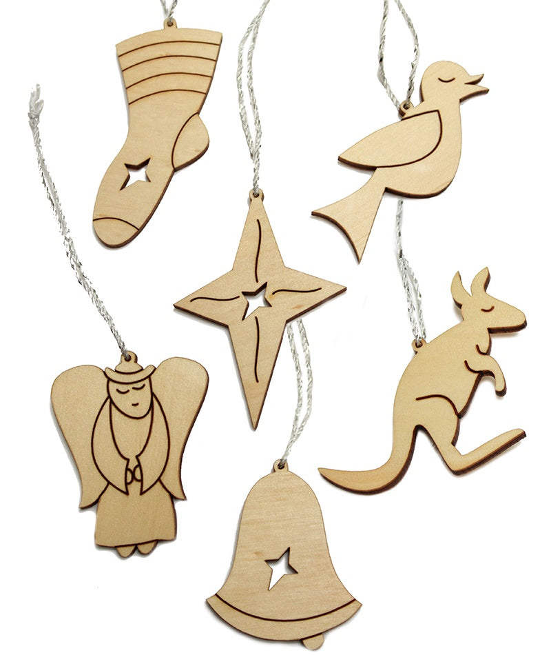 small pale wooden Christmas decorations in the designs of angel, bell, star, kangaroo, bird and stocking. Each decoration has a silver cord and dark line etching. some decorations have a small star cutout.