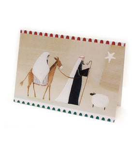 Religious design christmas card. simplified painted illustration in pale tones of Joseph leading mary on a donkey, with a sheep and a star and decorative elements.