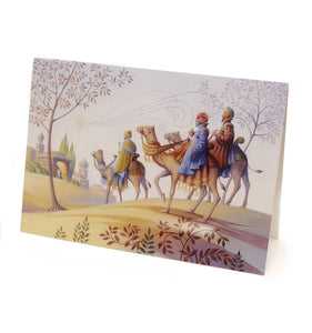 a detailed illustration in in pale lavender tones of the 3 wise men on camels