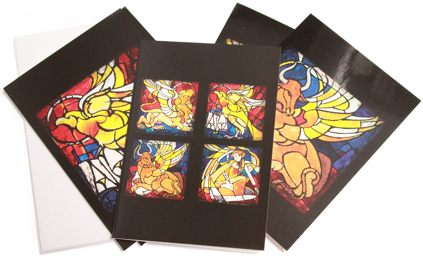 greeting cards showing bright stained glass images of the four evangelists, Matthew, Mark, Luke and John, represented by the angel, lion, ox and eagle