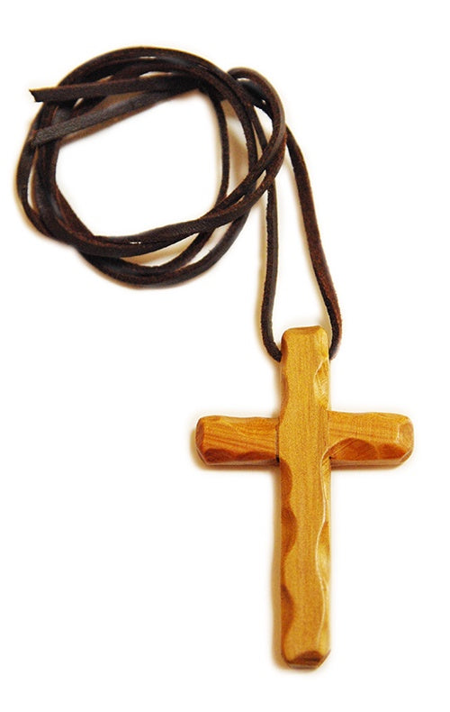 Wooden cross on leather