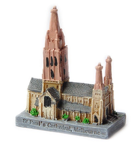 a small resin model of St Paul's cathedral, melbourne, Australia. 7cm by 5cm painted grey and light brown with one tall central spire and 2 smaller spires
