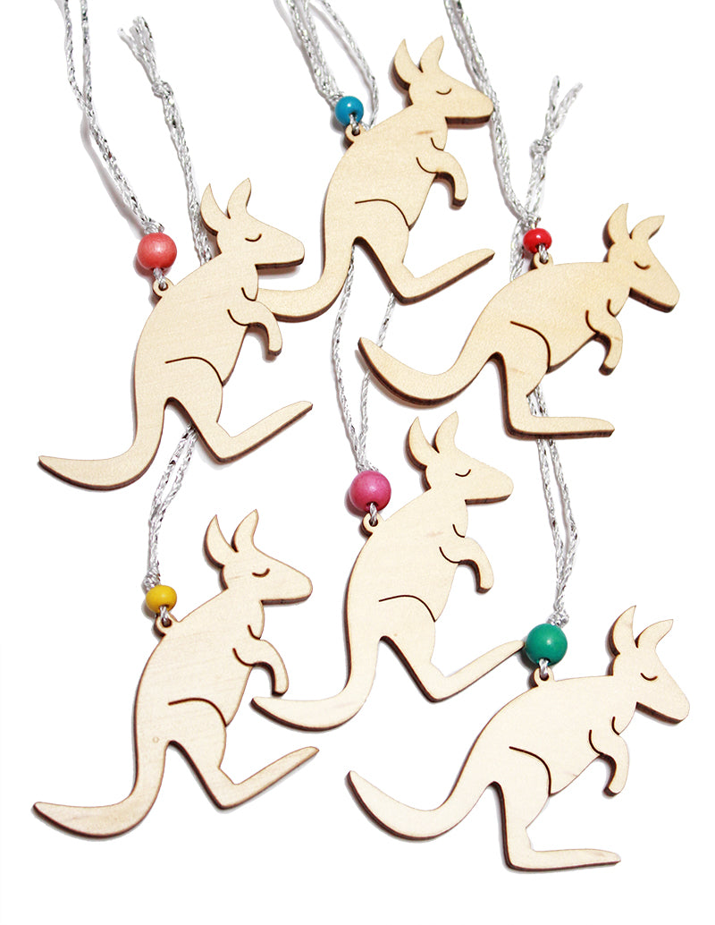 6 small wooden kangaroo christmas tree decorations. Each has a silver cord and a different coloured bead. Each kangaroo is 7cm across
