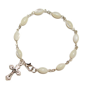 a 10 bead rosary bracelet of elongated mother of pearl beads separated by silver chain, incorporating a small silver crucifix