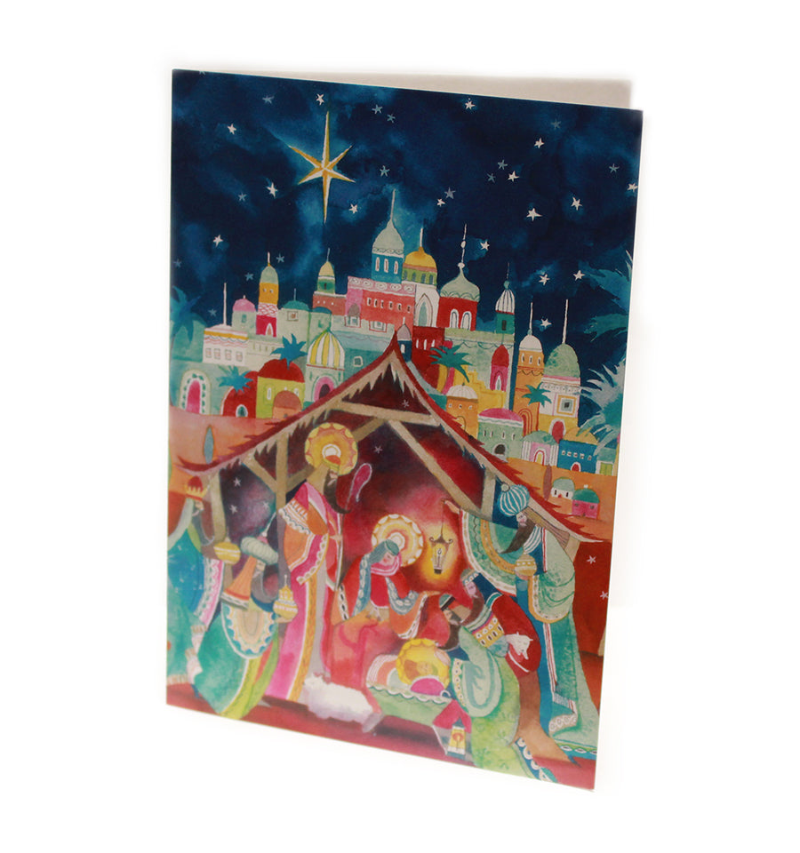 a religious design , painted illustration showing a dark sky with stars and a colourful scene with mary joseph baby jesus in the manger and the 3 wise men