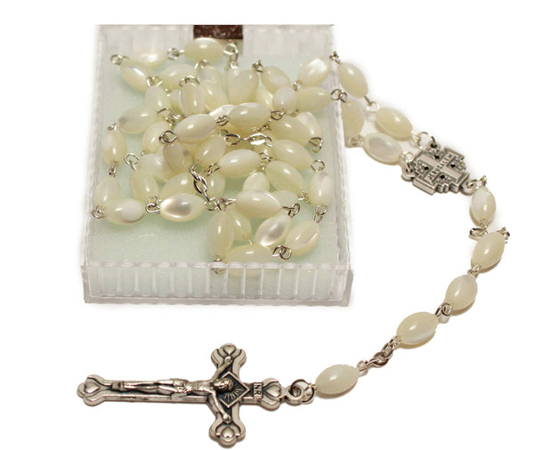 catholic rosary beads made of mother of pearl with a metal crucifix
