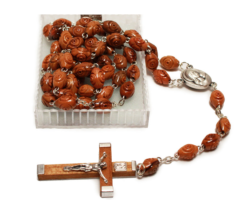 catholic rosary beads made of wood with a wooden cross with metal corpus