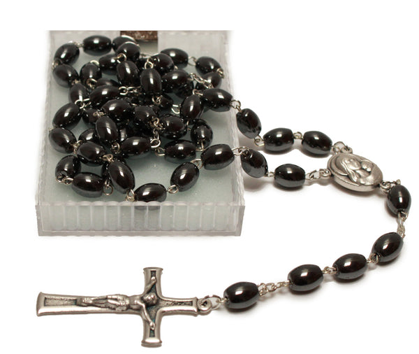 catholic rosary beads made of haematite with a metal crucifix