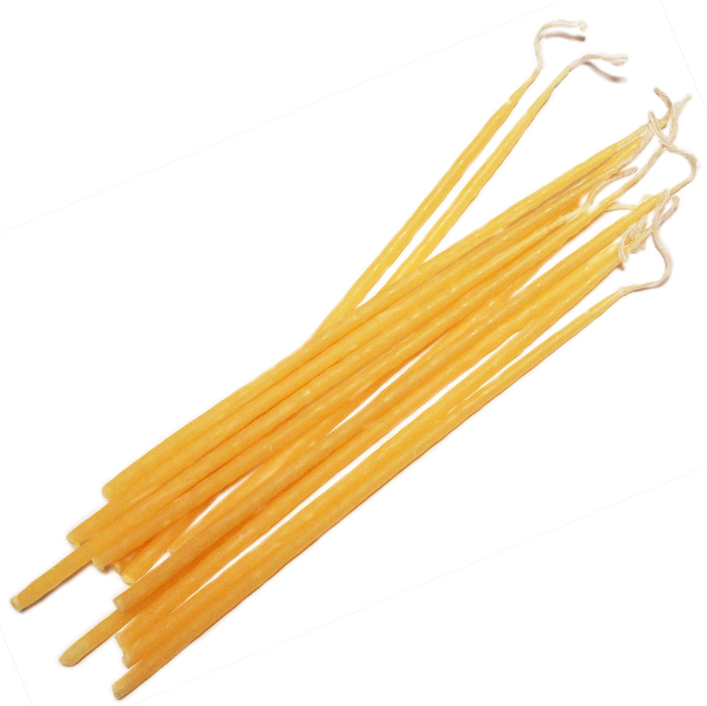 12 long thin yellow beeswax taper candles approximately 23cm long