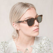 Mari & Clay sustainable sunglasses with female model wearing the Glenelg style in tortoiseshell. The style is simple, classic and modern, crafted with high-quality bio-acetate and polarised lenses.