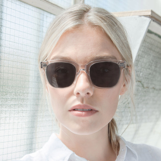 Mari & Clay sustainable sunglasses with female model wearing the Glenelg style in sand. The style is simple, classic and modern crafted with high-quality bio-acetate and polarised lenses.