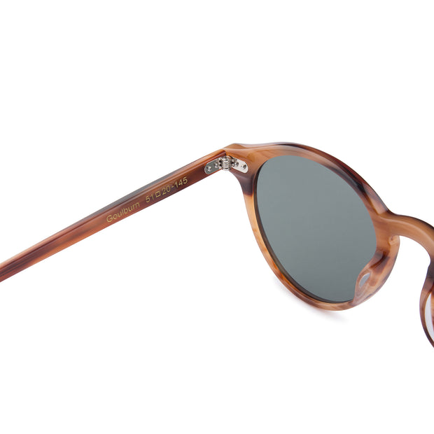 Mari & Clay Sustainable Sunglasses Goulburn Style in caramel bio-acetate frame with dark green polarized lenses. The Goulburn is a classic round design with thin rims to make it extra light-weight. Designed in Australia.