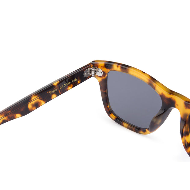 Mari & Clay Sustainable Sunglasses Yarra Style in tortoise shell bio-acetate frame with grey polarized lenses. These sunglasses are trapezoidal shape and thicker arms. Designed in Australia.