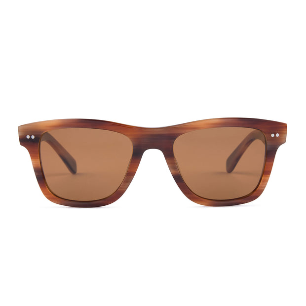 Mari & Clay Sustainable Sunglasses Yarra Style in caramel colour bio-acetate frames with brown polarized lenses. These sunglasses are trapezoidal shape with thicker arms. Designed in Australia.