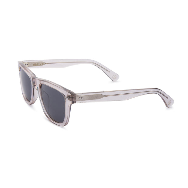 Mari & Clay Sustainable Sunglasses Yarra Style in transparent sand colour frames with grey polarized lenses. These sunglasses are trapezoidal shape with thicker arms. Designed in Australia. Made with bio-acetate.