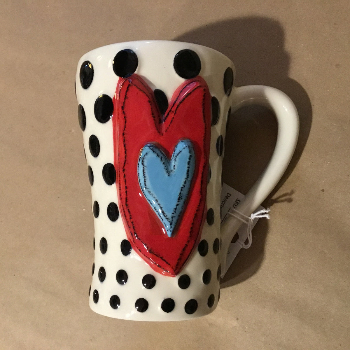Unique, artful mugs with a cheery heart accent.