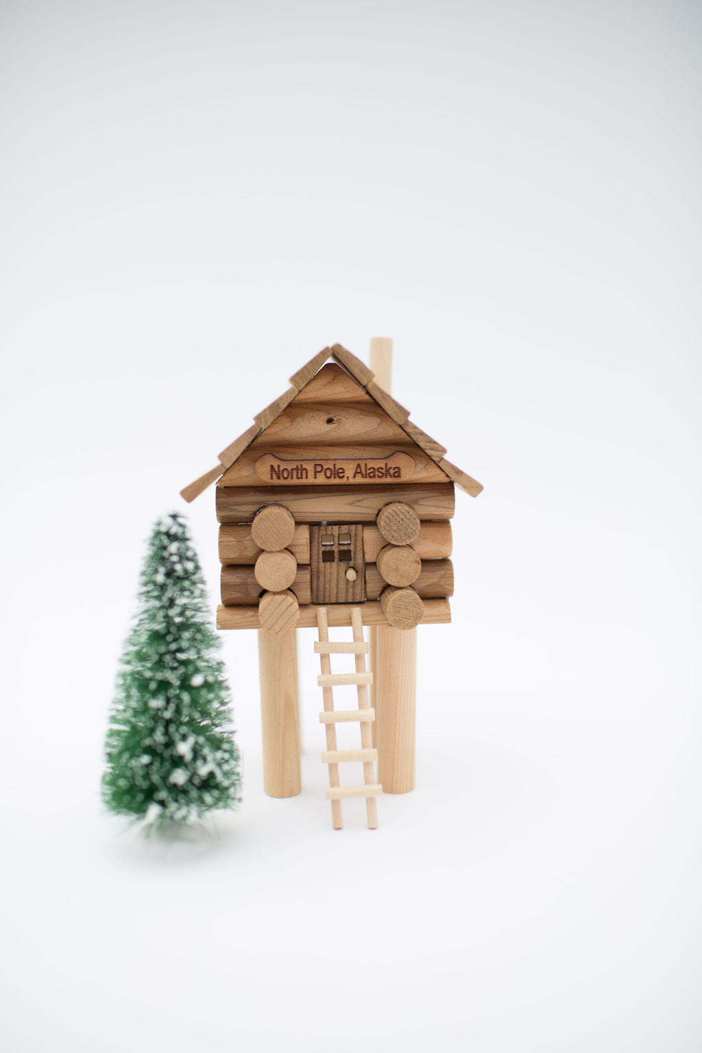 Build this miniature Alaska Cache Cabin with ladder made from real logs and available at Santa's Letters and Gifts-North Pole, Alaska