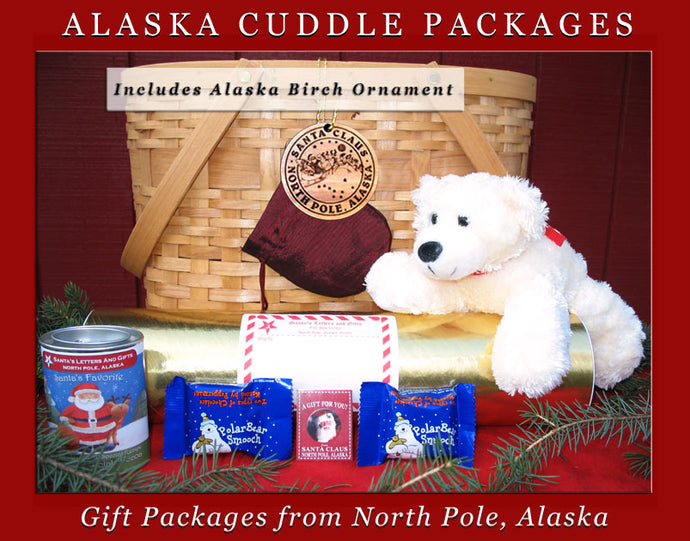 Alaska Cuddle Packages - Polar Bear, are one-of-a-kind gifts shipped in colorful mailing tubes stuffed with Alaskan gifts including a cuddly Alaska Critter, a personalized letter from Santa, a custom Birch Ornament from Alaska, North Pole Hot Cocoa and 2-3 Polar Bear Smooch Chocolate candies. Available from Santa's Letters and Gifts in North Pole, Alaska.