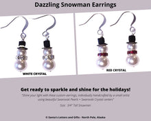 Load image into Gallery viewer, These dazzling Snowman Earrings are custom made by a small artisan using Swarovski pearls and crystal centers.  Snowman Earrings available with red or clear crystal center and packaged in attractive organza pouch with drawstrings. Send these earrings with our Deluxe Santa Letter and Tube Package during the Christmas Season. We also have limited necklace and earring sets, please email us if you are interested. Snowman Earrings available from Santa's Letters and Gifts in North Pole, Alaska.