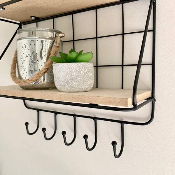 Black wire wall shelf with hangers