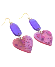 Load image into Gallery viewer, These 80's inspired Total Eclipse Heart Splatter Paint pink, purple, acrylic statement earrings are fun and will make you feel happy and cheerful, while adding the perfect pop of color to your wardrobe! Our colorful, eighties inspired earrings are handmade and designed with love in Las Vegas and like totally, make a statement!