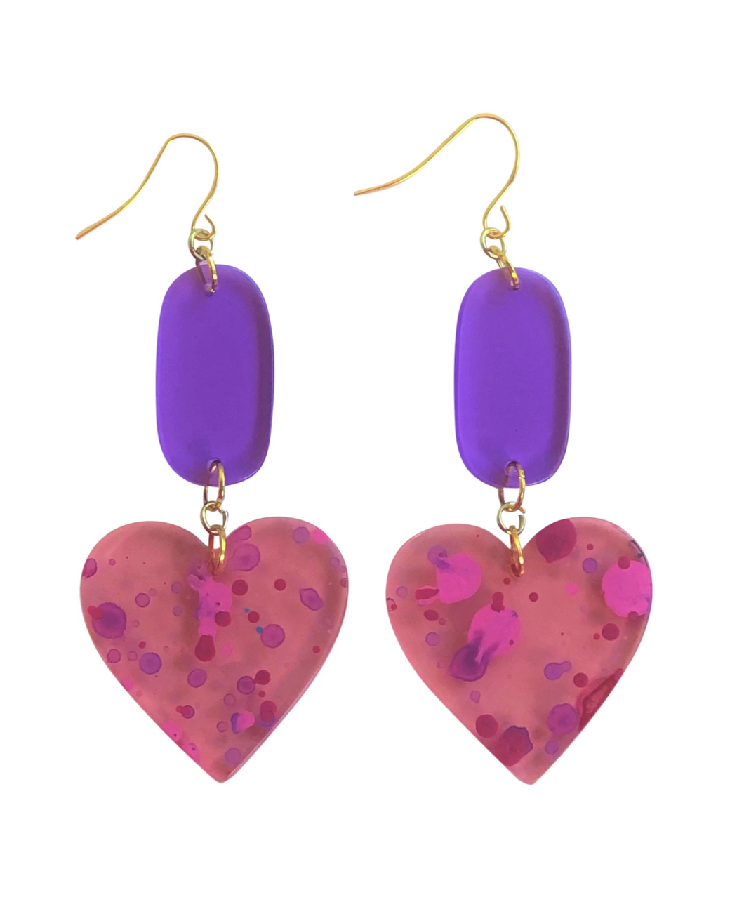 These 80's inspired Total Eclipse Heart Splatter Paint pink, purple, acrylic statement earrings are fun and will make you feel happy and cheerful, while adding the perfect pop of color to your wardrobe! Our colorful, eighties inspired earrings are handmade and designed with love in Las Vegas and like totally, make a statement!