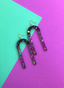 These 80's inspired Pump Up The Jam Splatter Paint purple, black, rainbow laser cut acrylic statement earrings are fun and will make you feel happy and cheerful, while adding the perfect pop of color to your wardrobe! Our colorful, eighties inspired earrings are handmade and designed with love in Las Vegas and like totally, make a statem