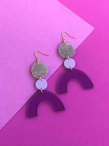 Discotheque purple, silver glitter rainbow geometric acrylic earrings are fun and will make you feel happy and cheerful, while adding the perfect pop of color to your wardrobe! Our colorful, eighties inspired earrings are handmade and designed with love in Las Vegas and like totally, make a statement!
