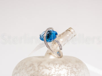18ct w/g Blue Topaz & Diamond ring