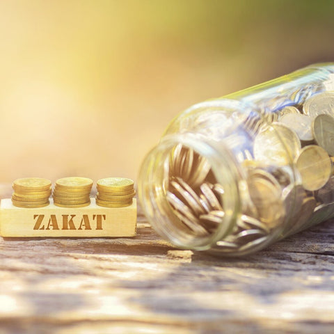 Give Zakat to needy person