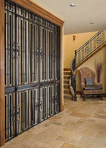 Entryway: Wine room doors and matching steel stair railing.